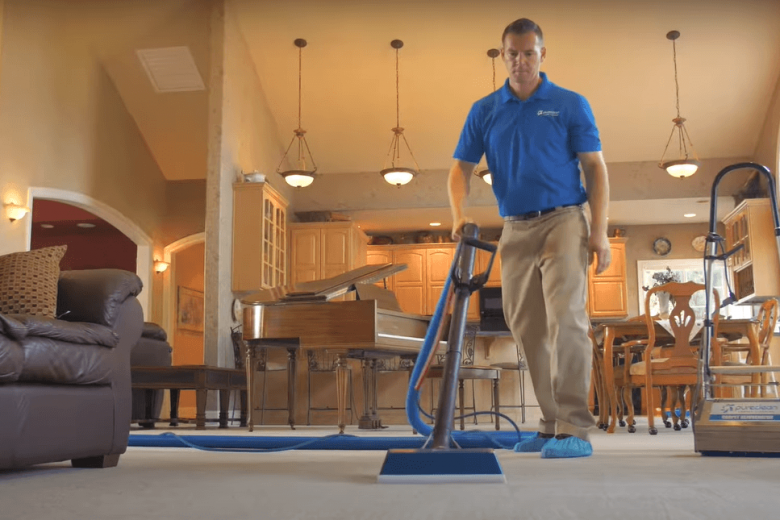 PureClean employee cleaning a residential carpet